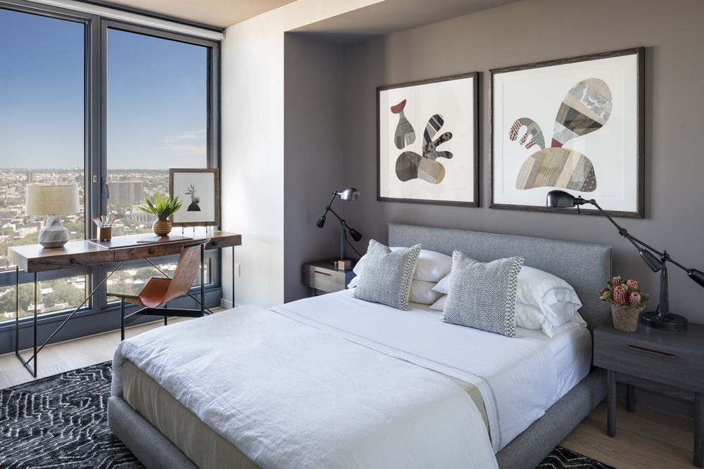 The Ashland: 37P a bedroom with a large bed in a hotel room