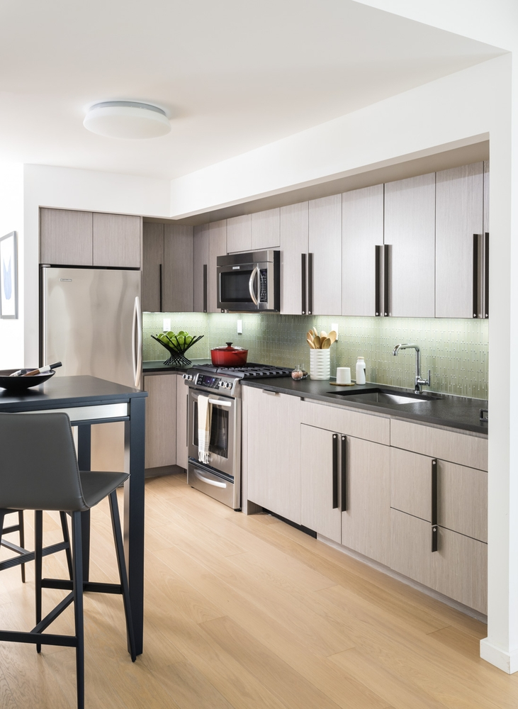 The Ashland: 34F a kitchen with an island in the middle of a room