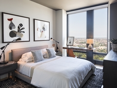 Thumbnail of The Ashland: 23N a bedroom with a large bed in a hotel room