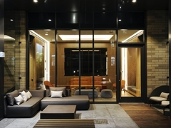 Thumbnail of The Ashland: 25K a living room with a large mirror