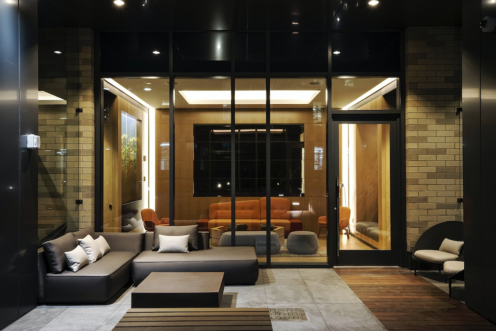 The Ashland: 25K a living room with a large mirror