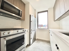 a kitchen with a stove top oven sitting inside of a building