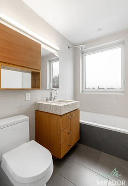 a room with a sink and a window