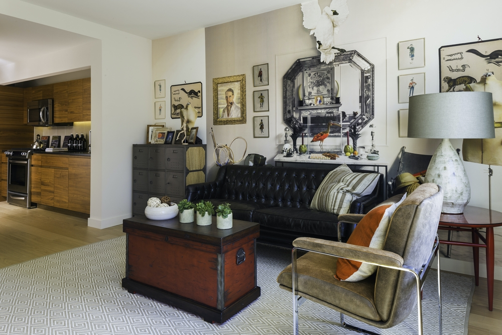 Gotham West: 736 a living room filled with furniture and a fireplace