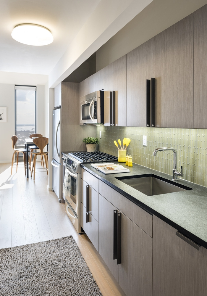 The Ashland: 27A a modern kitchen with stainless steel appliances