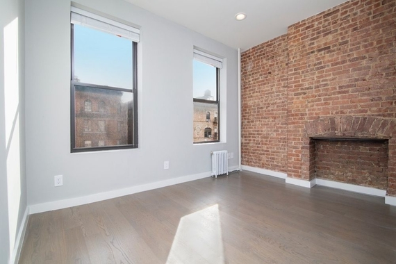 a large brick building with a window in a room