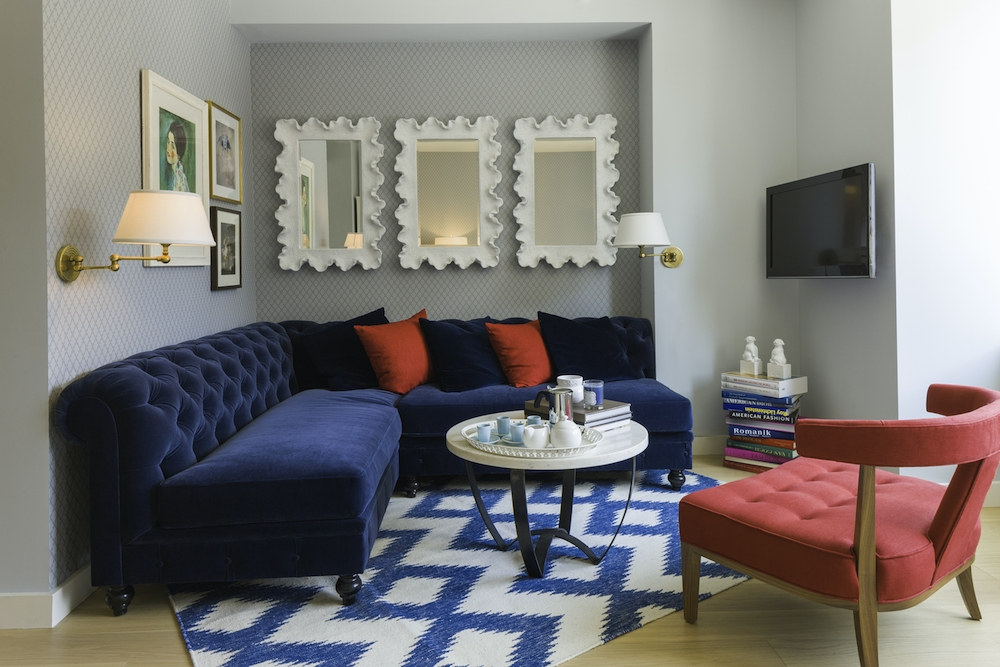 Gotham West: 512 a living room filled with furniture and a rug