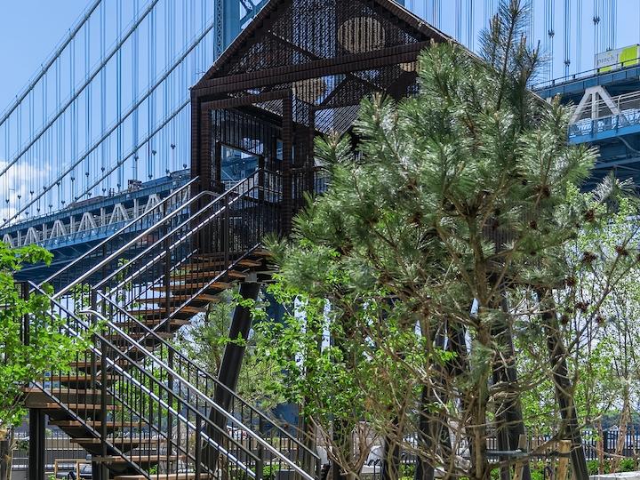 a bridge over a metal fence